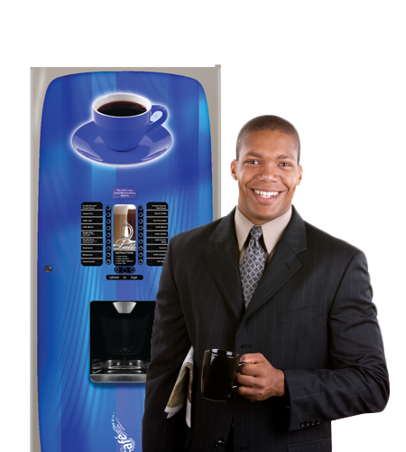 Happy employee in front of a coffee vending machine