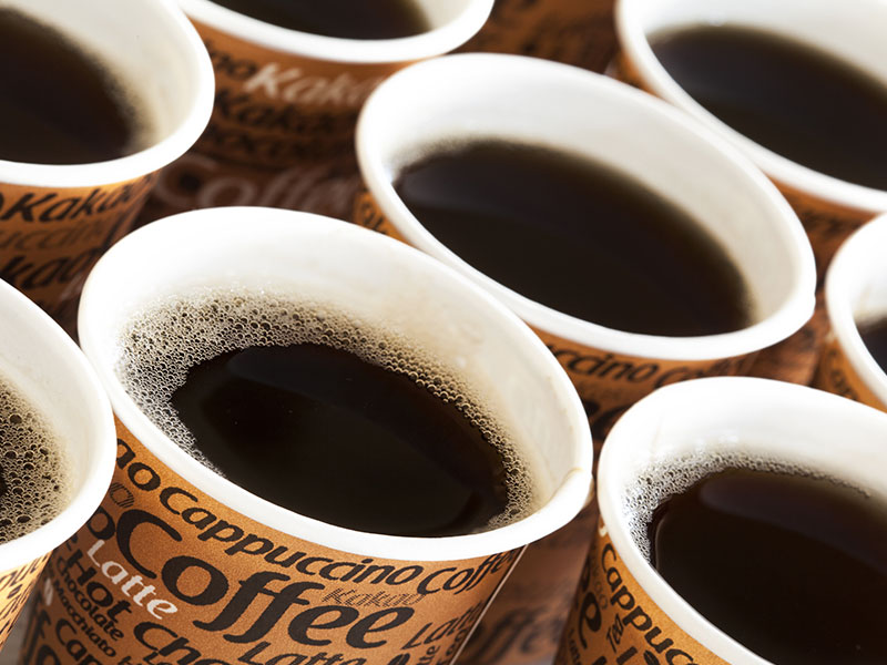 Paper coffee cups with hot coffee