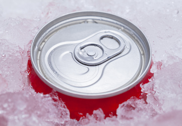 One Red Soda can from a Kenner vending machine Packed in Ice