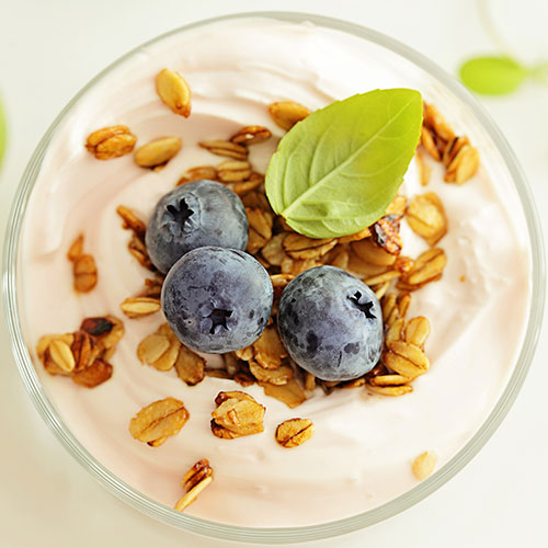 Healthy yogurt breakfast with granola and blueberries