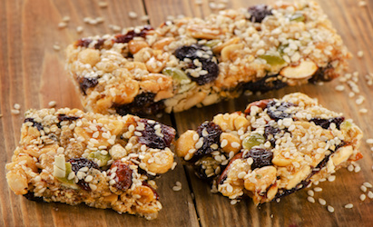 Healthy fruit and nut granola bars from a New Orleans East micro market on a wooden table