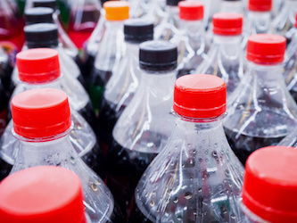 Carbonated soft drink bottles close up from Chalmette vending machines